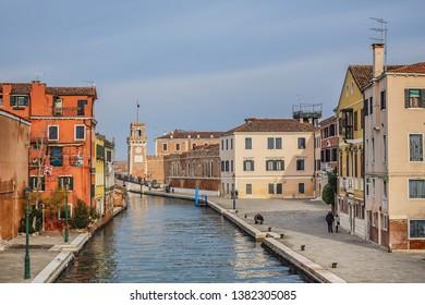 VENICE, ITALY - JANUARY 04, 2018: View of Venice Fondamenta De L'Arsenal street along canal Rio de l'Arsenal towards the Venetian Arsenal (Arsenale di Venezia, 1104).