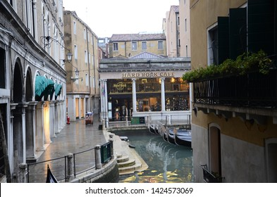 Venice, Italy - January 2 2013 : Hard Rock Cafe Location in Venice City with Lagoons docking outside
