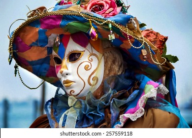 VENICE, ITALY - JANUARY 29, 2008: Unidentified person with Venetian carnival mask in Venice, Italy. At 2008 it is held from January 26th to February 5th.