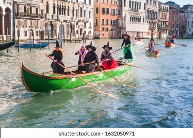 Venice, Italy - January 6 2014: Witches Rowing at Regatta of Befana in Venice, called Regata delle Befane. Bucintoro Rowing Club Racing from San Toma to Rialto Bridge on the Feast of the Epiphany
