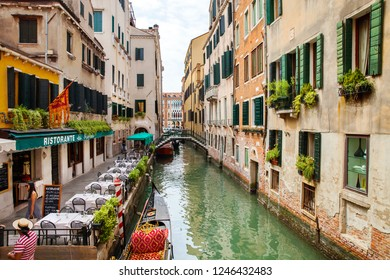 Venice, Italy - JUL 02, 2018: Street cafe on the canal in Venice