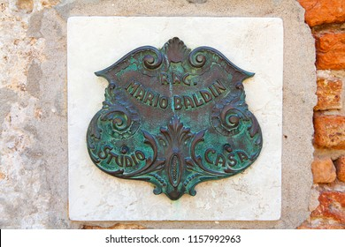 Venice, Italy - July 07 2018. Bronze embossed medallion on old wall in Venice, Italy