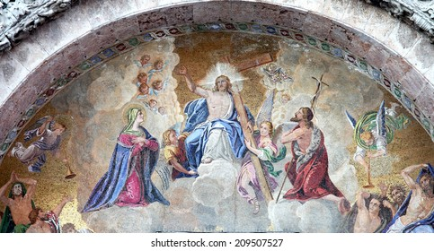 VENICE, ITALY - JULY 15, 2014: Exterior mosaic from st. Mark cathedral over the main portal. Jesus the King in the heaven and hl. Mary and st. John the Baptist.