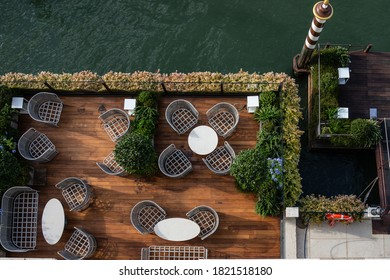 Venice, Italy - July 17 2020: Tables at a restaurant at the St. Regis Venice hotel facing the Canale Grande