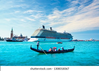 VENICE / ITALY - JULY 18, 2013: Celebrity Silhouette cruise ship and tourists in traditional Gondola in Grand Canal.
