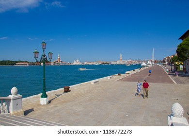 VENICE, ITALY - JULY 18 2014: the wide walkway next to the Grand Canal before very many people showed up