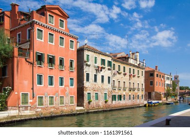 VENICE, ITALY - JULY 18 2014: three and four story buildings on one of canals in Venice