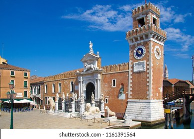 VENICE, ITALY - JULY 18 2014: statues of varying sizes at the entrance to an ornate building in Venice