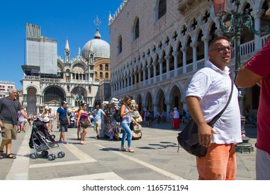 VENICE, ITALY - JULY 18 2014: a crowded street near Saint Marks Square