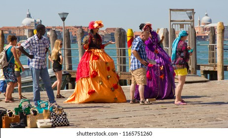 VENICE, ITALY - JULY 18 2014: street vendor and performers on the Grand Canal