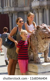 VENICE, ITALY: JULY 18 2014: a lion, girl, boy and a woman in Venice