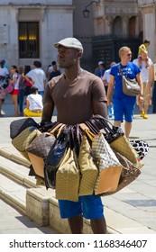 VENICE, ITALY: JULY 18 2014: a seller of handbag near Saint Mark's Square