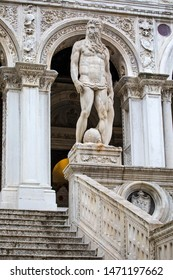 Venice, Italy - July 18th 2019: A statue of Neptune - the Roman God of the Sea, located at the Giants Staircase at the Doges Palace, also known as Palazzo Ducale in Venice, Italy.