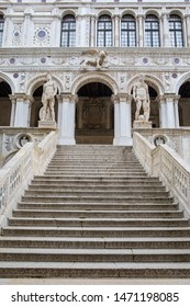 Venice, Italy - July 18th 2019: The Giants Staircase at the Doges Palace, or also known as Palazzo Ducale in the city of Venice, Italy.  Statues of Mars and Neptune guard the top of the staircase.