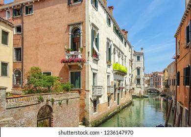 Venice, Italy - July, 2014: City in northeastern Italy, capital of Veneto region. Typical Italian residential architecture. Apartment building in Italian city Venice. region on Adriatic Sea Sunny day.