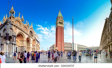 VENICE, ITALY -JULY, 2016: Panorama of Piazza San Marco with the Basilica of Saint Mark and the bell tower of St Mark's Campanile (Campanile di San Marco) in Venice, Italy, July 22, 2016.
