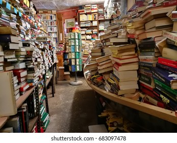 Venice Italy, July 2017: Aqua alta bookstore, the most charming place to buy second hand books, situated right at the canal entrance and being overflooded several times a year