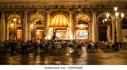 Venice, Italy, July 2017. Famous terraces and cafes in the San Marco square, during the night. While the customers drink or eat something, there is live music entertaining the evening.