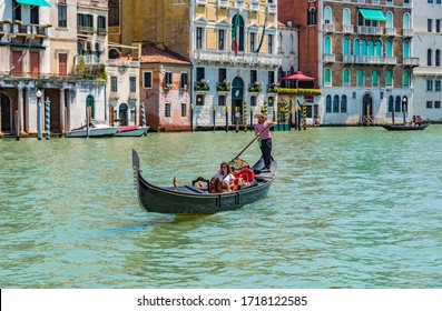 VENICE, ITALY - JULY 3, 2019: The gondola is a traditional, flat-bottomed Venetian rowing boat, well suited to the conditions of the Venetian lagoon.