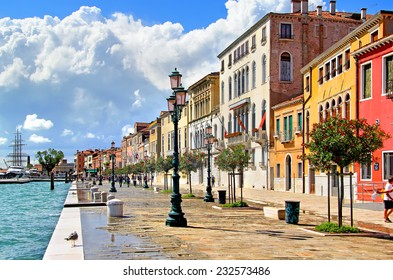 VENICE, ITALY - JULY 30, 2014: The central embankment in a cloudy and sunny day.