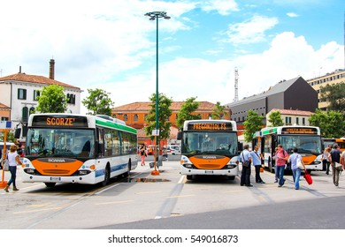 VENICE, ITALY - JULY 30, 2014: White city buses Scania OmniCity CN94UB at the bus station.