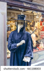 VENICE, ITALY - JULY 5, 2016: Traditional venetian manikin in Plague doctor costume, mask and hat near shop window in the street of Venice