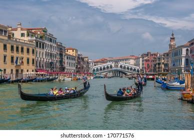VENICE, ITALY - JUNE, 09, 2011: Gondolas at Grand Canal in Venice, Italy on June, 09, 2011