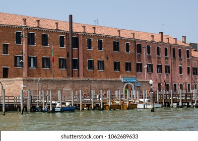 VENICE, ITALY - JUNE 13, 2017:  View from a canal of the main police station in Venice with police boats moored outside.