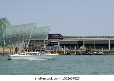VENICE, ITALY - JUNE 13, 2017: The shuttle train leaving the station which takes passengers from cruise ships over a canal and into the historic city of Venice.