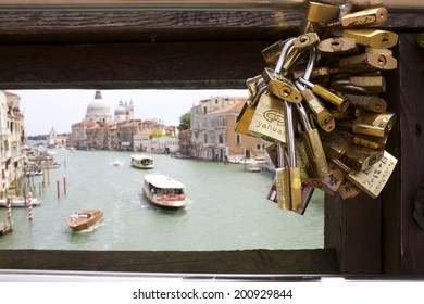 VENICE, ITALY- JUNE 15,2014: Locks on bridge above Grand Canal in Venice, Italy on June 15, 2014. Grand Canal is lined with more than 170 buildings, most which date from the 13th to the 18th century.