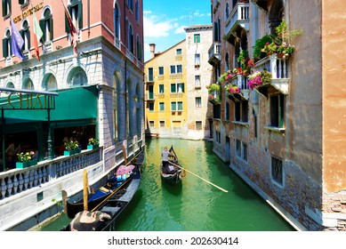 VENICE, ITALY - JUNE 16: The gondola with tourists is on water channel on June 16, 2014 in Venice, Italy. More then 46 mln tourists is expected to visit Italy in year 2014.