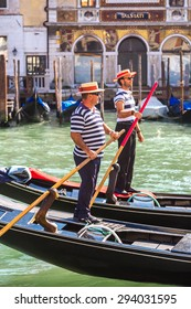 VENICE, ITALY - JUNE 18, 2014: Gondola on Canal Grande in Venice, in a beautiful summer day in Italy on June 18