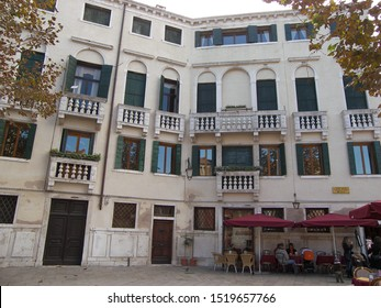 VENICE, ITALY, June 2007: touristic trip. Travel view of Venice houses featuring house palace balconies. The image location is Venice in Italy, Europe.