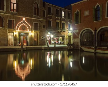 Venice, Italy, June 21, 2012 . Tourists spend the evening in a cafe on the canal bank
