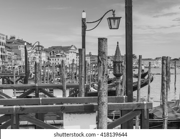 VENICE, ITALY - June 26, 2014: Tourists travel on gondolas in Venice, Italy. Gondola ride is the most popular tourist activities in Venice . Black and white photography.