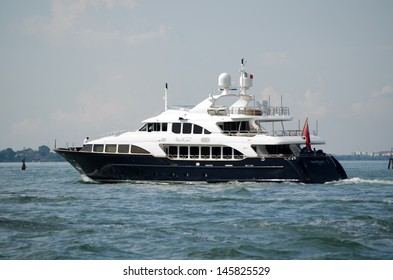 VENICE, ITALY - JUNE 6: The luxury yacht Sea BlueZ sailing through the Venetian lagoon on June 6 2013.  The mega-yacht is one of the most expensive in the area.