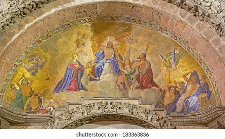 VENICE, ITALY - MARCH 11, 2014: Exterior mosaic from st. Mark cathedral over the main portal. Jesus the King in the heaven and hl. Mary and st. John the Baptist.