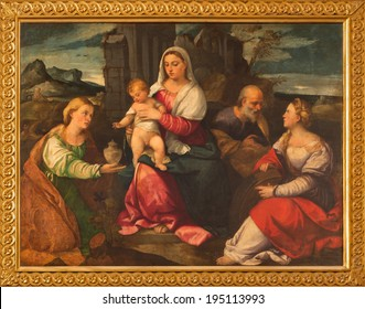 VENICE, ITALY - MARCH 13, 2014: The Holy Family with st. Mary Magdalen and st. Katherine by Bonifacio de Pitati (1487 - 1553)  in church Chiesa di San Stefano.