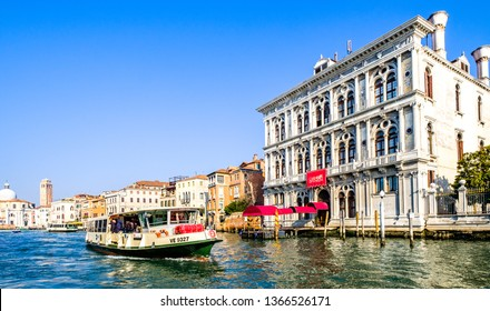 Venice, Italy - March 15: typical traffic with boats on the waterways and canals in venice, italy on March 15, 2019