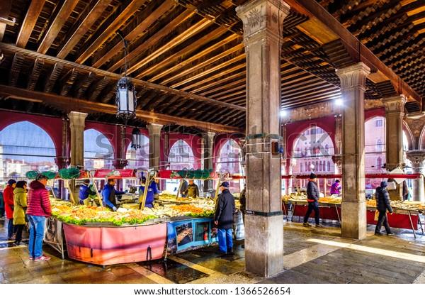 Venice, Italy - March 16: famous Mercato di Rialto - fish- and farmers-market near the rialto bride in venice on March 16, 2019