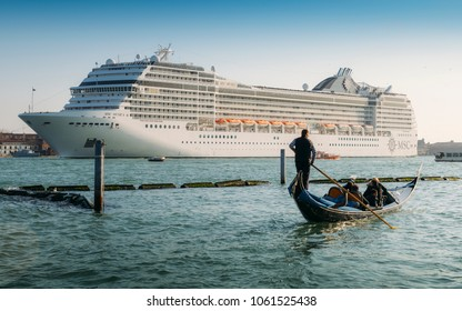 Venice, Italy - March 25, 2018: Cruise ship and Venetian Gondola. Old vs new types of transportation