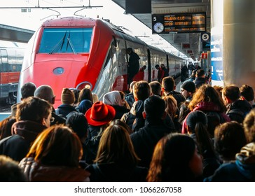 Venice, Italy - March 26th, 2018: Passengers at platform next to a Frecciarossa high speed train