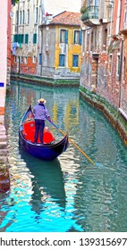VENICE ITALY, MARCH 30 gondola in a canal of the Venice Italy lagoon March 30 2019 Venice Italy