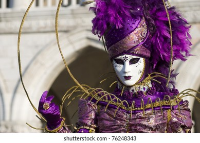 VENICE, ITALY - MARCH 4: A street performer poses in traditional costume for the Carnival celebration in San Marco Square on March 4, 2011 in Venice, Italy.