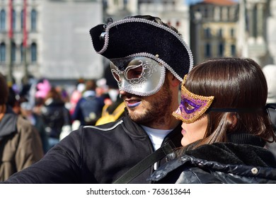 Venice, Italy - March 6, 2011: Unidentified  couple of participants in masks makes a selfie on the St. Mark's Square during the Carnival of Venice