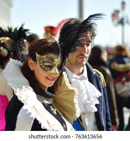 Venice, Italy - March 6, 2011: Unidentified  participants in costumes on St. Mark's Square during the Carnival of Venice. The 2011 carnival was held from February 26th to March 8th