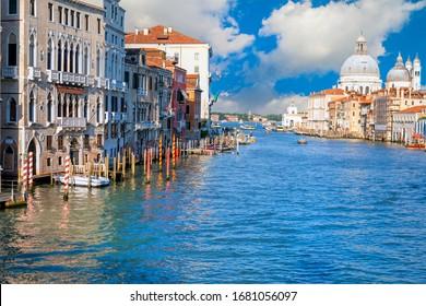 Venice, ITALY - MAY 05 2016 : Beautiful view of Grand Canal and Basilica Santa Maria della Salute in Venice, Italy.