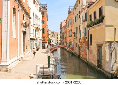 VENICE, ITALY - MAY 06, 2014: People near picturesque bridge over a narrow canal in Venice, Italy