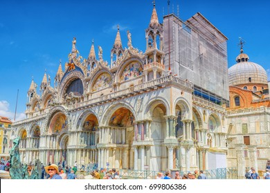 VENICE, ITALY - MAY 12, 2017 : Square of the Holy Mark (Piazza San Marco) and St. Mark's Cathedral (Basilica di San Marco) with tourists, Italy.