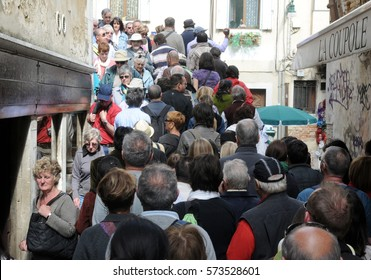 VENICE, ITALY - MAY 18, 2012: Crowds of tourists at the narrow streets of Venice.